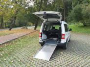Vehicle for carry one wheelchair